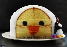 If you haven't tried a hidden centre cake, like M&S's Penguin Party Madeira Cake, above, it's high time you did