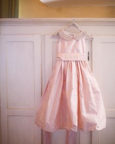 Oh I love this one! This flower girl dress is sooooo lovely! I wish I could plan my own wedding all over again and have my thee little girls to wear a dress like this one! #flowergirldress #flowergirl #pastelcolordress #flowergirls #bridalpartydresses #weddingideas #weddingcolors #pinkwedding #blushcolor #blushtheme #getmarriedagain #littlegirldresses