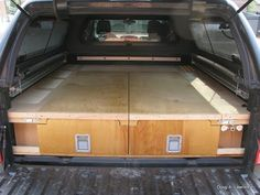 """The entire top of each drawer pulls out to act much like a fridge slide. This will let us load heavy objects with ease. Side wings with access hatches to the wheel-well areas were added along with """"pockets"""" at the tailgate to house the important stuff. You can also see the faucet installed on the far right."""