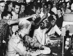Lunch Counter Sit-In, Jackson Mississippi, 1963: Civil Rights demonstrators being taunted and covered with sugar, mustard and ketchup.