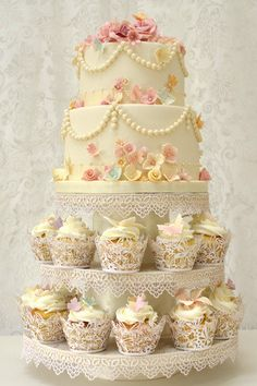 Love the lace edging & the cupcakes & the string of pearls on the top cake.