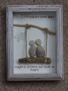 Driftwood framed pebble and seaglass picture of two friends swinging on a driftwood swing. A seaglass butterfly flits by! This is a lovely picture ideal gift for a best friend. The words read: True friends are never apart, maybe in distance but never in heart.