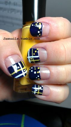 Yellow & white dots and stripes on dark blue tips nail art