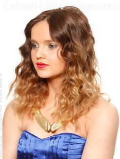 Goddess Ombre    A soft blend from a natural light brown to a sun kissed blonde paired with curly waves is stunning! This is a beautiful color that has longevity and worry-free maintenance. This type of color is great for the busy lady who can't schedule regular appointments at the salon. With a slightly higher blend of the lightest color around the face. this color is perfect for spring!