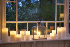 Candles are always so romantic and beautiful in front of this window......