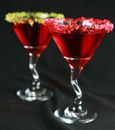 Jolly Rancher Martinis: Jolly Rancher Martini Cocktail Jolly Rancher candies (optional) 1 oz watermelon flavored vodka** 1 oz Sour Apple Pucker / Sour Puss Apple 1 oz Sour Raspberry Pucker / Sour Puss Raspberry 1/2 oz Rose's Sweetened Lime Juice 4 oz cranberry juice