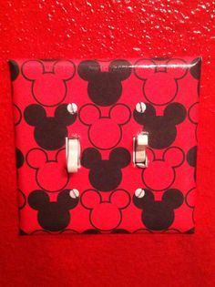 Mickey Mouse light switch cover I made with scrapbook paper and mod podge