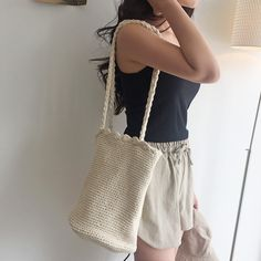 Accessorize your laidback look with a hot weather arm candy including this sleek and chic knit shoulder bag!