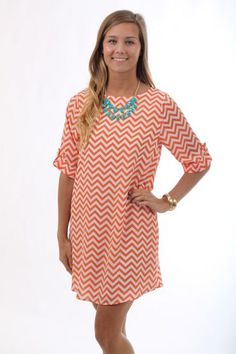 Mesmerizing Chevron Dress, orange $42 www.themintjulepboutique.com  Love this! Just need to add some navy jewelry and its an instant Auburn outfit!