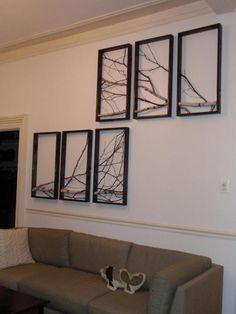 Branch art using multiple frames. I've been considering doing a single large frame for the living room, but I like this idea, too!