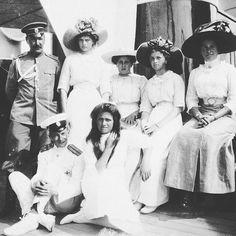 "The Grand Duchesses Tatiana,Maria and Olga Nikolaevna Romanova of Russia with Anya Alexandrovna Vyrubova,lady in waiting and officers on the Imperial Royal yacht.  ""AL"""