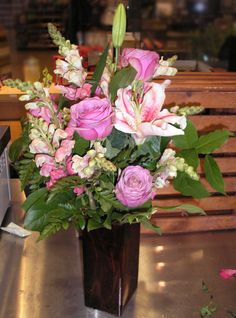 Cool water roses, star gazer lilies, and pink snapdragons in a deep ...