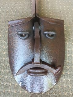 Shovel face  Railroad spike nose mustache  Added new eyes.