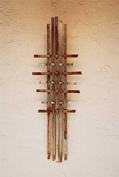'Wall Sculpture 3' by American artist Jeff Owen. Steel, 36 x 24 x 3 in. via the artist's site