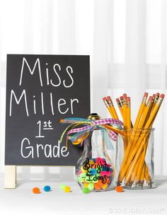 "Gear up for the school year with desk decor that's anything but ordinary! DIY TIP: Create your own ""Bright Ideas"" container with a light bulb jar embellished with ribbon and paint."