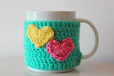 Crochet cup cosy crochet mug cosy Easter mug cosy by AnaisandAiyla Mug Cozy Pattern, Crochet Coffee Cozy, Crochet Kitchen, Knitting For Beginners, Loom Knitting, Crochet Yarn, Yarn Crafts, Craft Fairs, Crochet Projects