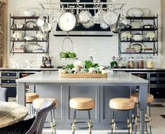 okay-- this is it. subway tiles, black shelves, white lowers with marble tops. Black sconces on either side of window