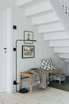 my scandinavian home: A Light-filled, Pared-Back Coastal Home In Halland, Sweden. Bench under the stairs with Muuto floor lamp and textiles. White Wash Walls, Swedish Interiors, Interiors Magazine, Pine Floors, Piece A Vivre, Under Stairs, Scandinavian Home, Coastal Homes, Country Chic