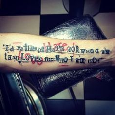 Arm Lettering Trash Polka Tattoo by World's End Tattoo