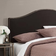 Upholstered black headboards provide a strong anchor for your bed, particularly when used against white, cream or gray walls.