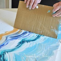 Here's a fun DIY wall art project - apply acrylic paint with cardboard.