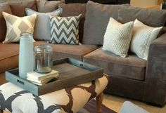 Grey couch neutral pillows; for downstairs basement when finished