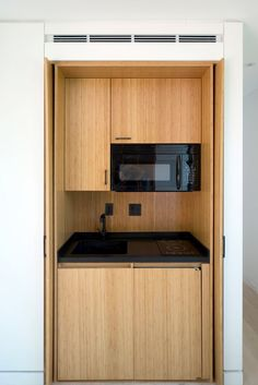 Kitchen with hinged pocket doors Tiny House Fit for the Hamptons - The New York Times Cuisine avec p Micro Kitchen, Hidden Kitchen, Küchen Design, Home Design, Interior Design, Small Modular Homes, Tiny Homes, Hotel Door, Small Apartment Kitchen