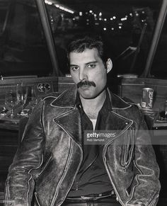 Freddie Mercury of Queen on board a train (De Kameel) from Leiden to Amsterdam, Netherlands, after a gig at Groenoordhal, Leiden, 25th April 1982.