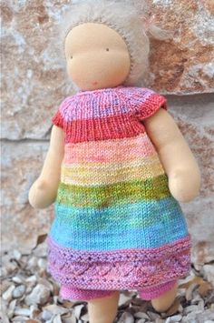 hand knitted dress on a beautiful Waldorf doll