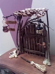 fairy door with lantern, broom, and sign