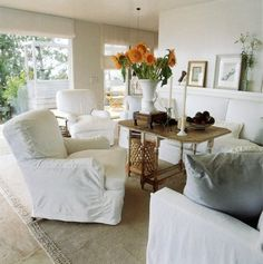 Vicente Wolf ~ his home in Montauk.  Always love white slip-covered furniture!