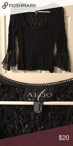 Women's top Women's black stretch long sleeve top with sheer angel sleeves. Material is puckered and stretches. Only worn once, great condition! Tops Blouses