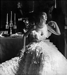 1951 Dovima in ruffled lace party dress by Jane Derby