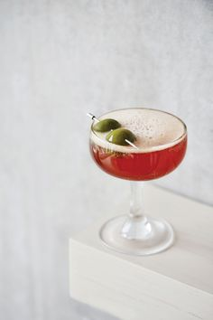 The Safe Passage cocktail is a riff on a cocktail called the Sweet Olive from Brooklyn restaurant Franny's, featuring ingredients like Castelvetrano olive brine and fresh peppermint-infused bitter, Amaro Nardini.