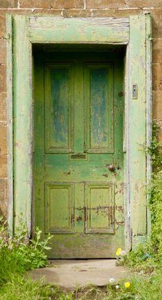 Adderbury, Oxfordshire, England, old wooden door, green, weathered, cracks, charming, beauty, entrance, doorway, aged, vintage, bricks, door knob,