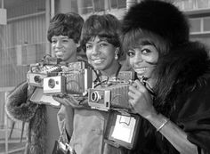 The Supremes arrive at London airport before taking part in the television shows Ready Steady Go and Thank Your Lucky Stars. L-R Florence Ballard, Mary Wilson and Diana Ross in 1965.