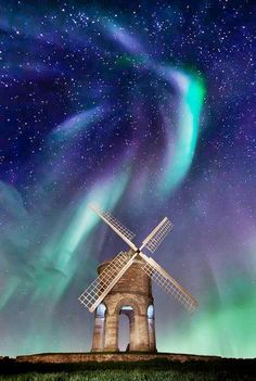 Simple stone windmill under the Northern Lights Photographer or artist unknown. (Feel free to comment if you know!)