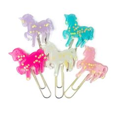 This gorgeous unicorn paper clip is made out of resin and has tiny iridescent stars inside! Each unicorn is mounted on top of a gold jumbo paperclip. The unicorn paper clip comes in five beautiful col