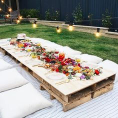 Why not throw a picnic-style party? What looks like a fancy set-up will only take you minutes to put together. Use some crates as a table and set out a blanket and some pillows and everyone will be nice and cozy while they eat their di