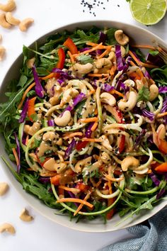 Zucchini Noodle Pad Thai Salad with Sesame-Cashew Dressing is made fresh raw carrots, zucchini, cabbage, arugula, red peppers!