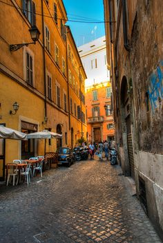 A small street in Rome, Italy. The city is filled with historical Italian artifacts but also still represents the small-scale Italian life that is displayed in the photograph.