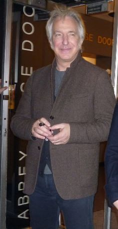 Alan with cigar!>>>>> I think it's a pen. He quit smoking decades ago.