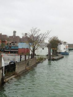 Hurricane Sandy Slideshow: Frankenstorm Arrives -- Daily Intel  Rising Banks of the Gowanus Canal. http://nymag.com/daily/intel/2012/10/hurricane-sandy-slideshow-frankenstorm-in-photos.html?mid=twitter_nymag#photo=9x00014