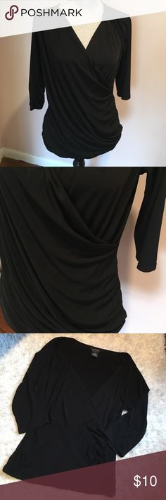 sexy v-neck faux wrap shirt In excellent condition, only worn once. 93% polyester, 7% spandex. Measures approximately 19.5 inches from armpit to armpit and 25 inches from shoulder to hem.smoke and pet free home. George Tops Blouses