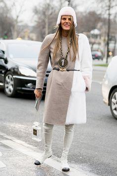 Ann Dello Russo rocking a color lock coat, Chanel boots and bag in Paris.