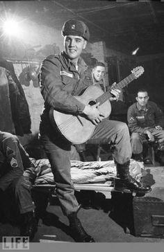 Private Elvis Presley entertains his tank battalion in his barracks, Germany, November 1958.