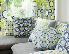 Clarke and Clarke - Impressions Fabric Collection - Blue and green bold printed round and square cushions with modern flower patterned curtain Curtain Patterns, Fabric Patterns, Discount Wallpaper, Clarke And Clarke Fabric, Spring Theme, Pattern Mixing, Inspired Homes, Color Trends, Colorful Interiors