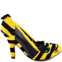 You'll fall in love with the Audrey by Irregular Choice.  This cuddly style features a black and yellow yarn covered upper with leather panels.  An adorable tiger face presents itself on the vamp, complete with ears and tail adorning the silhouette.  Adding a slight amount of height is 3 3/4 inch heel.