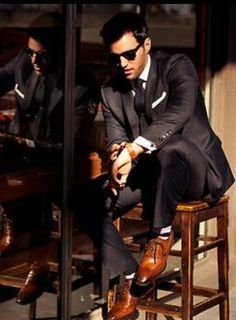 black suit saddle brown shoes