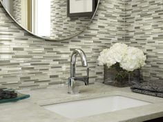 """The ultimate bathroom glass tile!  In style """"Atomic Glass"""" . Within the design of the glass colors is a painted strie effect that creates a subtle ombre look. By Shaw Floors"""